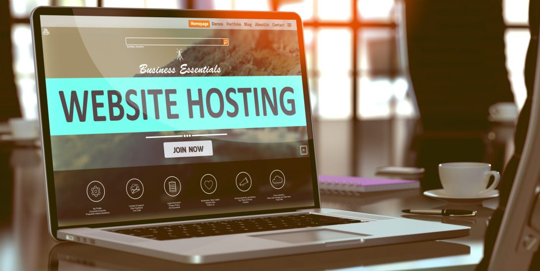Website Hosting Concept. Closeup Landing Page on Laptop Screen  on background of Comfortable Working Place in Modern Office. Blurred, Toned Image. 3D Render.